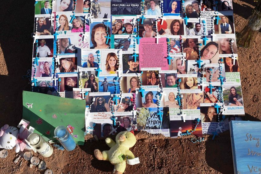Photos of some of the 58 victims at a makeshift memorial in Las Vegas.