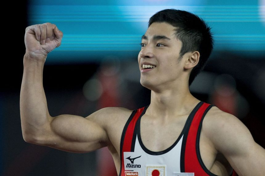 Shirai, third in Thursday's men's all-around competition (above), kept his crown with 15.633 points.