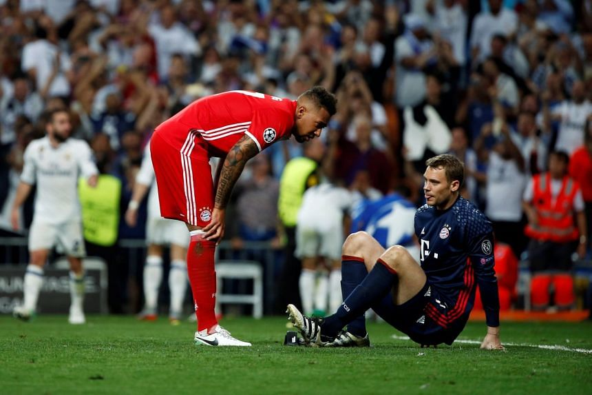 Bayern Munich's Jerome Boateng checking on goalkeeper Manuel Neuer after he injured his left foot during their Uefa Champions League quarter-final second leg against Real Madrid at the Santiago Bernabeu stadium in Spain on April 18, 2017.