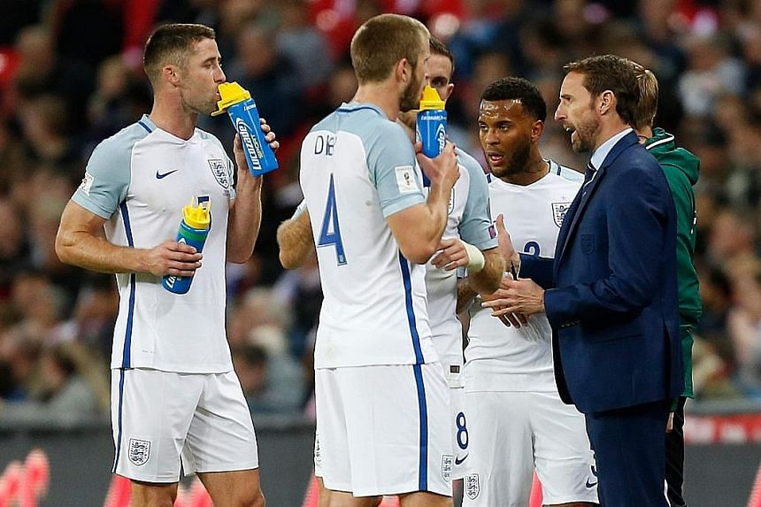 England manager Gareth Southgate giving his players a pep talk during their World Cup qualifier against Slovenia at Wembley on Thursday. They were booed by some supporters and needed a stoppage-time goal from Harry Kane to win 1-0 and secure qualific