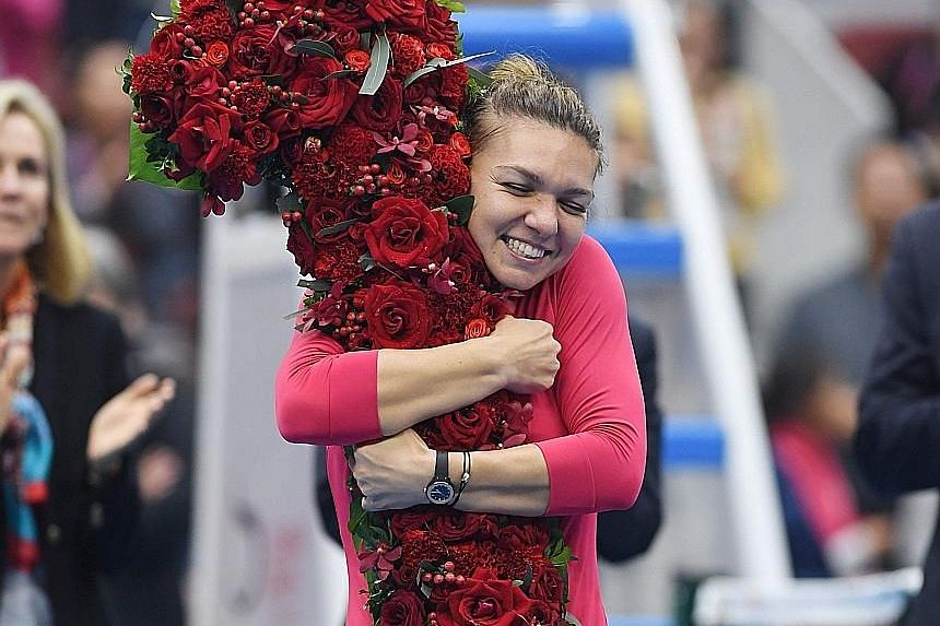 A dream come true for Simona Halep - the first Romanian to reach the highest rung in WTA history - as she hugs a giant flower arrangement in the shape of a figure '1' after making the final of the China Open.