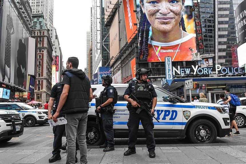 Members of the New York City Police Counterterrorism force standing guard in Times Square in August. US federal officials on Friday disclosed that a plot to detonate bombs in Times Square and the New York City subway system last year had been quietly