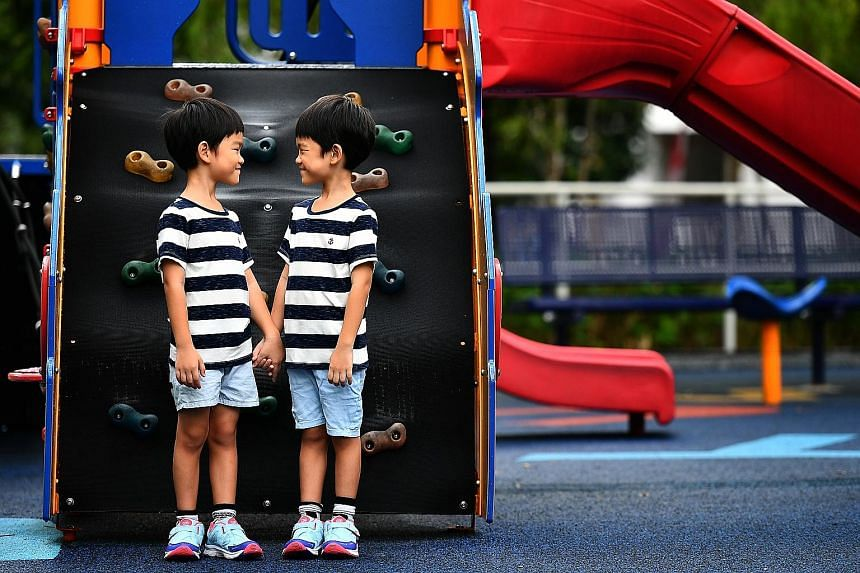 Twins Chua Yong Kang (far left) and Yong Le, five, attend a kindergarten in Sengkang. The boys' mother spends $6,000 a year on their fees, and pays another $1,200 a year for field trips, concert costumes and books for a reading programme.