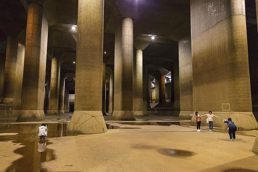 Above: Visitors at the Metropolitan Area Outer Underground Discharge Channel, an anti-flood system in Kasukabe. Left: The control room of the underground site.
