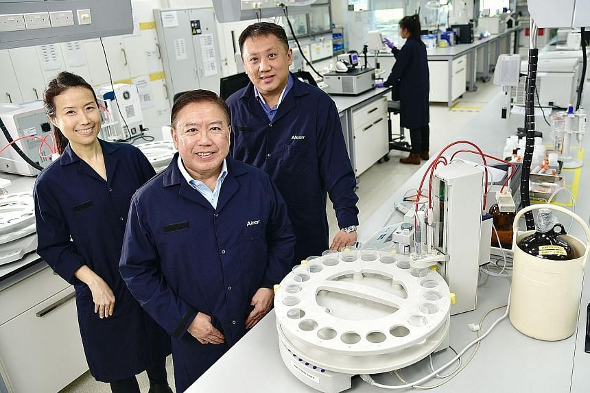 Alcon Manufacturing and Logistics' (from far left) head of human resources Elsie Lim, 46, general manager Mark Chua, 59, and head of replenishment centre Joel Ang, 44.