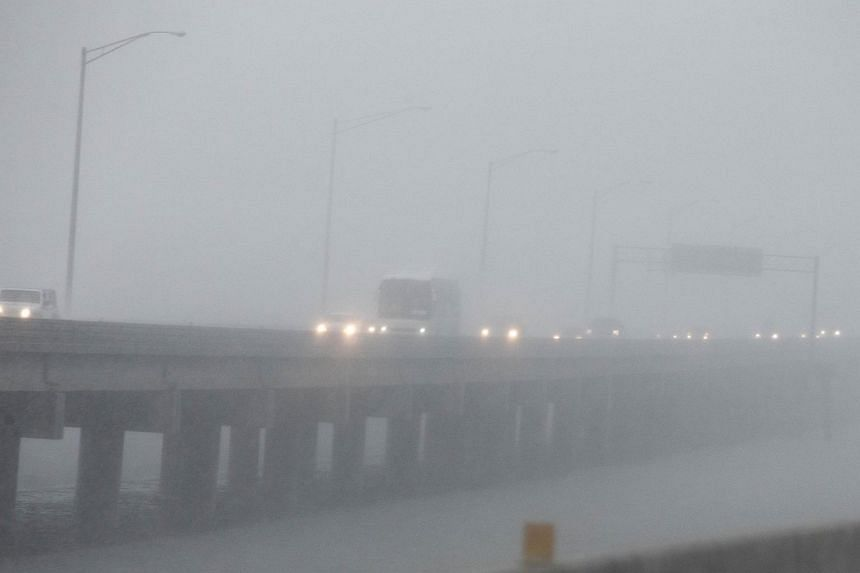 Traffic streams east over Mobile Bay which is under a hurricane warning as Hurricane Nate approaches the northern Gulf Coast on Oct 7, 2017 in Alabama.