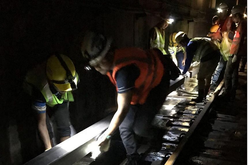 Officers from SCDF, PUB, LTA and SMRT worked through the night on Saturday (Oct 7) to clear the water in the tunnel between Bishan and Braddell stations. PHOTO: LAND TRANSPORT AUTHORITY