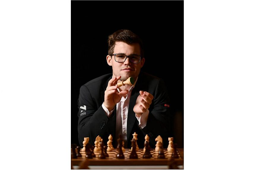 Magnus Carlsen at the Norwegian Ambassador's residence last Friday, when he played against 16 opponents simultaneously and beat them all. Though his international rivals have closed the gap, he is confident of preparing well in his bid for a fourth w