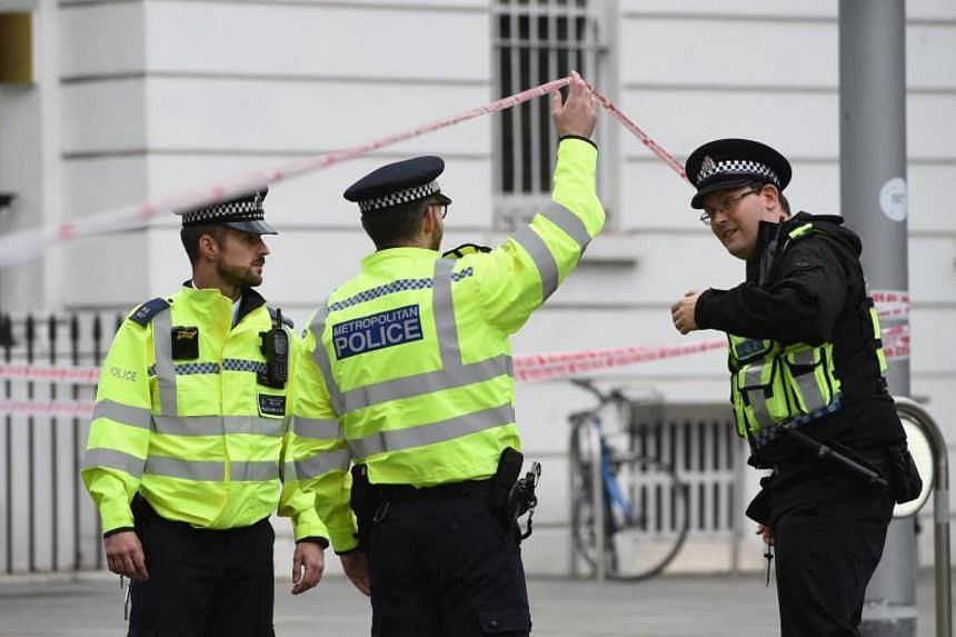 Police officers standing guard near the Natural History Museum in London after a vehicle mounted the pavement and hit several pedestrians, on Oct 7, 2017.