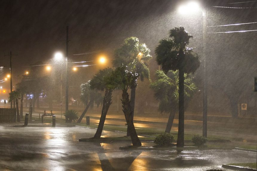 Rain sweeps across the streets in Biloxi, Mississippi, as the eye of Hurricane Nate sweeps ashore, on Oct 8, 2017.