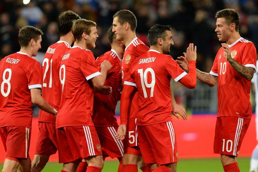 Russia's players celebrate during the friendly in Moscow.