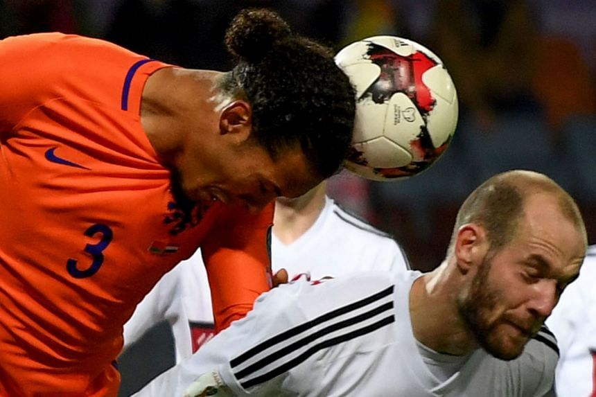 The Netherlands' Virgil Van Dijk (left) and Belarus' midfielder Ivan Maevski vie for the ball.