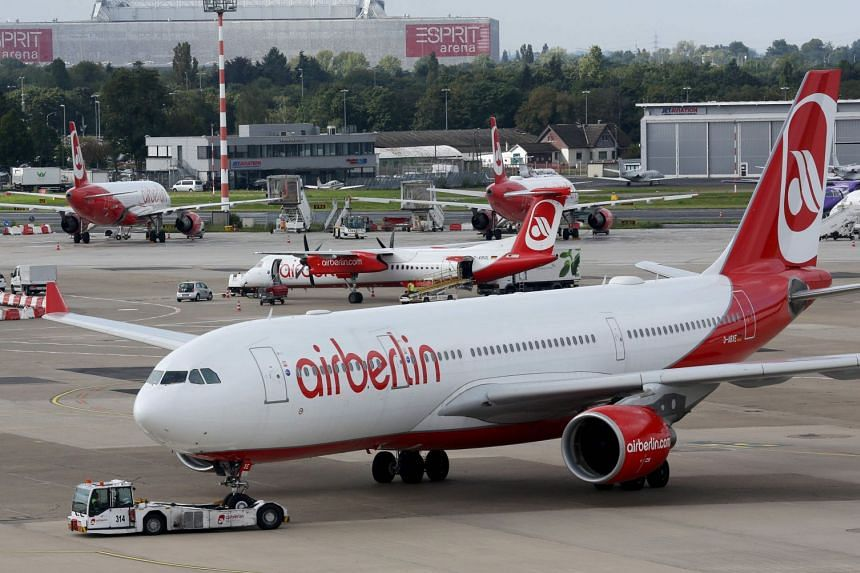 Air Berlin planes parked iin Duesseldorf, after the troubled airline had to cancel flights, Sept 12, 2017.