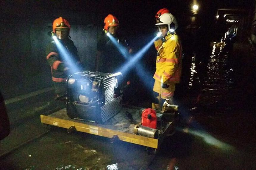SCDF personnel working to remove water from the MRT tunnels between Bishan and Braddell stations.