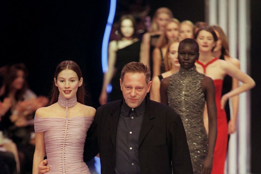 Mr Herve Leroux at a show of his collection in 1999. He made his iconic dress from bands of yarn meant to be thrown away.
