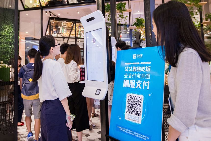 "A customer trying out Alipay's facial recognition payment solution ""Smile to Pay"" at a KFC restaurant in Hangzhou, Zhejiang province, last month. The public's growing exposure to the technology in various fields also means facial recognition is likel"