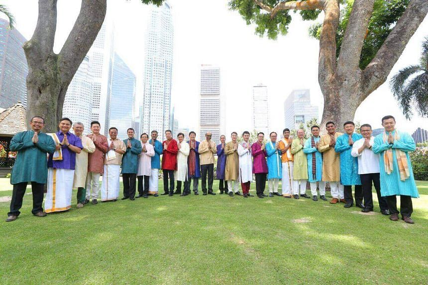 Deputy Prime Minister Tharman Shanmugaratnam (centre), together with 23 ministers and MPs, gamely pose for photos on the Parliament House lawn on Monday, Oct 2, 2017.