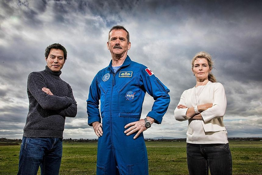Mr Chris Hadfield (centre) is joined by anaesthetist and trauma doctor Kevin Fong and space psychologist Iya Whiteley in Astronauts: Toughest Job In The Universe.