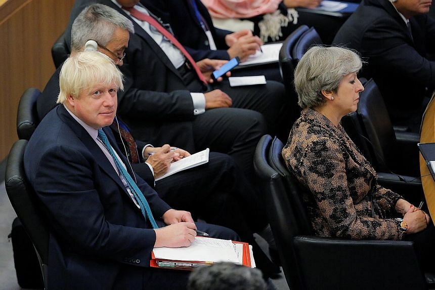 British Prime Minister Theresa May and Foreign Secretary Boris Johnson at the UN General Assembly last month. Mr Johnson has been accused by some of undermining Mrs May.