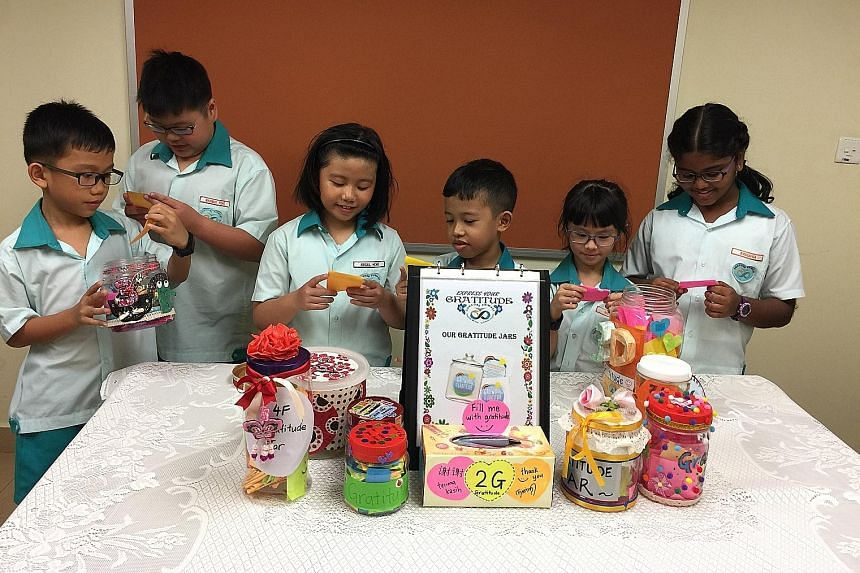 Concord Primary School pupils reading notes from their gratitude jars, which are part of the Gratitude Project which the school introduced last year.