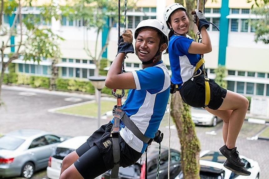 Muhammad Hamizan Akid and Zoe Wee participating in an abseiling activity during a PE lesson. Northbrooks' Outdoor Education Programme exposes students to activities such as rock climbing and abseiling, orienteering and kayaking.