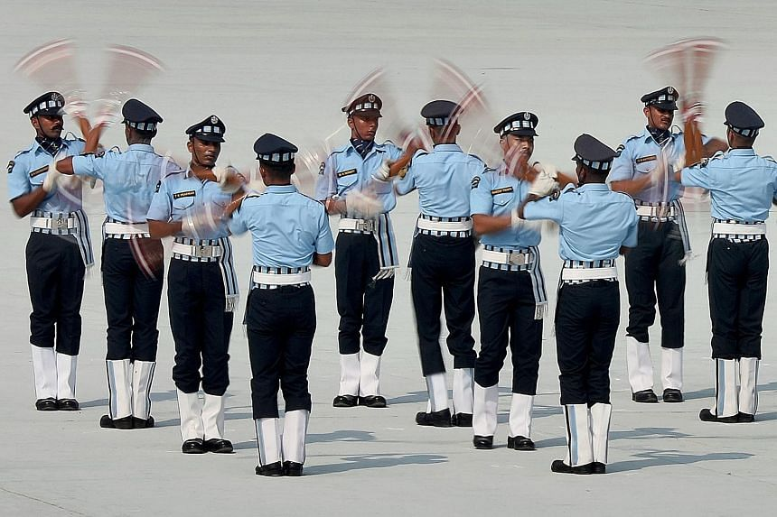 A drill team showing off their skills during the Indian Air Force Day celebrations at Hindon Air Force Station on the outskirts of New Delhi yesterday. The air force celebrated its 85th anniversary yesterday.