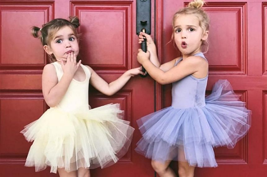 Mila (left) and Emma Stauffer, two-year-old twins who have done advertising work for companies such as Amazon, Macy's and Walmart. They became stars after appearing in a video on their mother's Instagram page that garnered 4.4 million views.