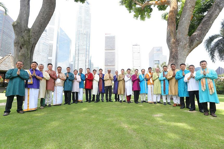 The 24 Members of Parliament, including Deputy Prime Minister Tharman Shanmugaratnam (12th from left), dressed in traditional Indian attire, posing for the Deepavali photoshoot on the Parliament House lawn last Monday. Mr Tharman said the MPs enjoyed