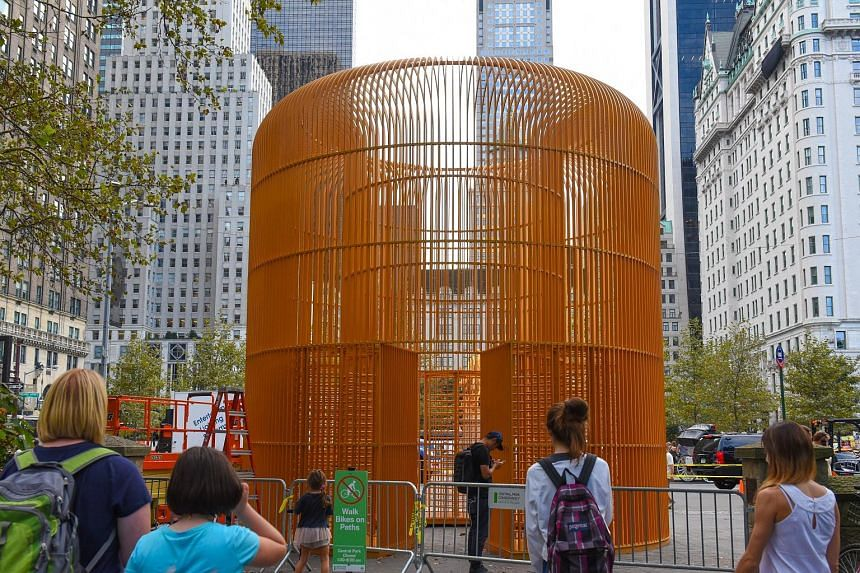 Another sculpture (left) is constructed under the Washington Square Arch (left below). One of Ai Weiwei's sculptures for his project, Good Fences Make Good Neighbours, near Central Park in New York City.