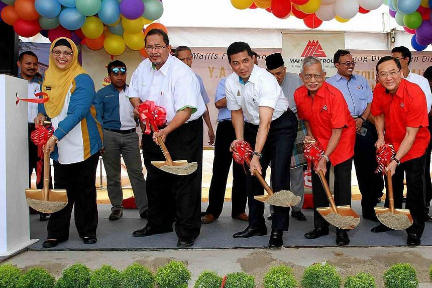 Selangor Menteri Besar Azmin Ali (third from far left) at the groundbreaking ceremony for a building project. He is reported to have gone overseas recently to market the state to foreign investors.