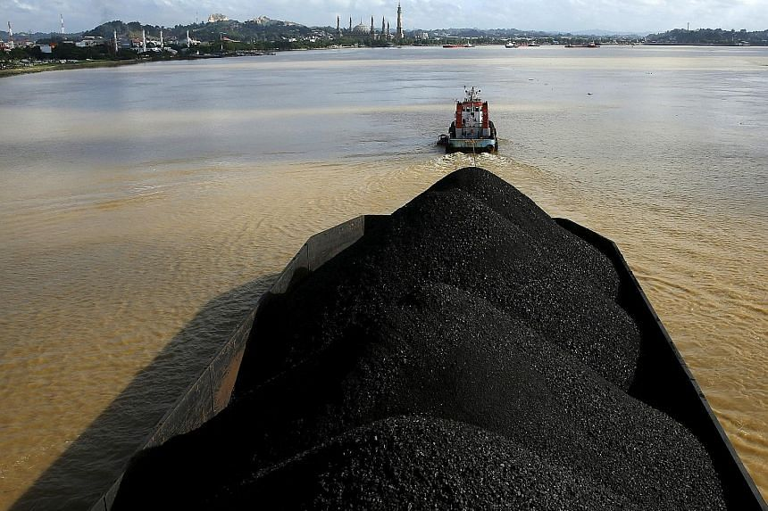 A tugboat pulling a coal barge along the Mahakam River in East Kalimantan, Indonesia. Mr Phil Rickard is CEO of BlackGold, which holds the rights to three coal concessions in Sumatra.