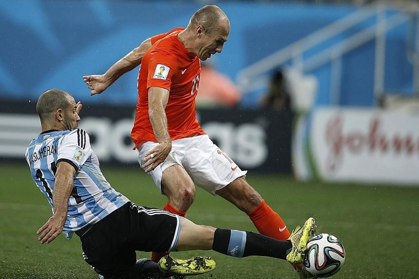 2014: Arjen Robben being tackled by Argentina midfielder Javier Mascherano during their World Cup 2014 semi-final in Sao Paulo on July 9. The Netherlands went on to lose 2-4 in the penalty shoot-out after the match ended 0-0 after extra time.