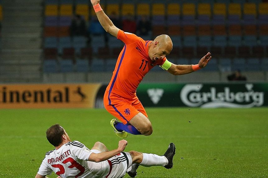 2017: Robben, now the Dutch captain, riding a challenge from Sergei Balanovich during their 3-1 World Cup 2018 qualifier win in Belarus. World Cup semi-finalists in 2014, both the Netherlands and Argentina are facing the shock prospect of failing to