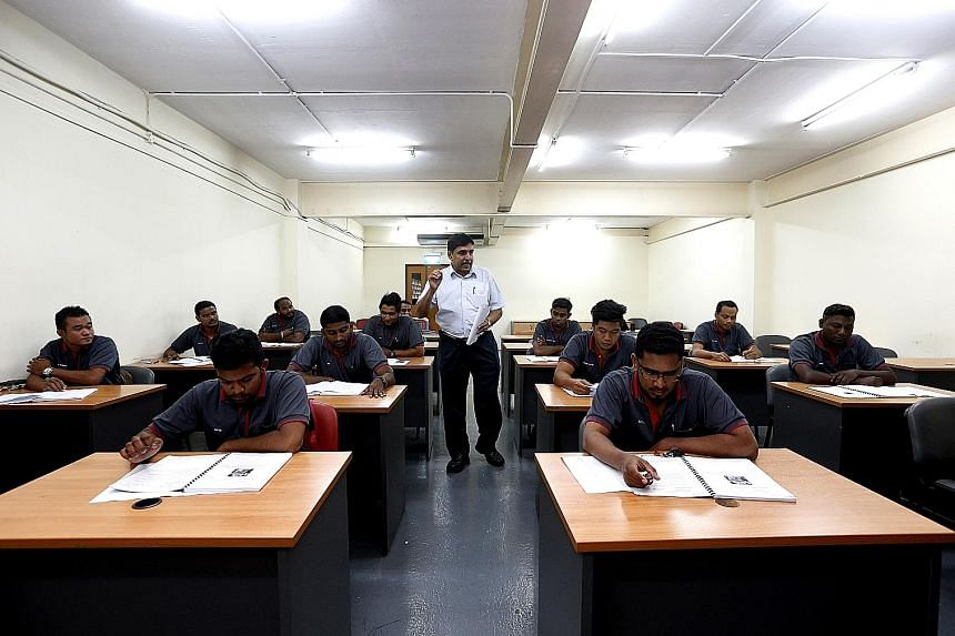 Department manager Karmachand Sahu holding a theory class at Fujitec Singapore. The company offers courses in lift and escalator technology under a train-the-trainer scheme in collaboration with ITE.
