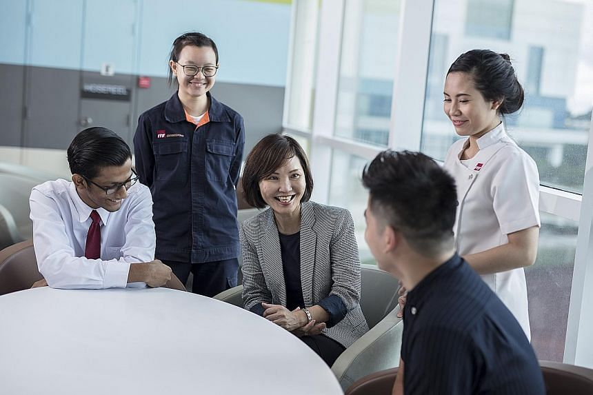 ITE chief executive Low Khah Gek (centre) with some of the school's students. She believes its ability to respond swiftly to industry changes and provide effective hands-on learning places it in a unique position to train adults who are keen to upgrade th