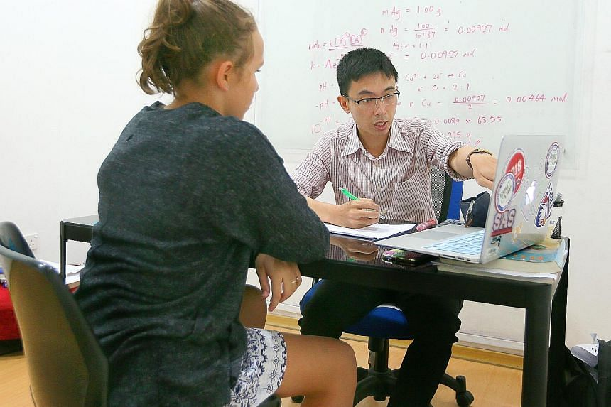 Mr Shaun Lim of Student's Inn teaching an international student last Thursday. From 15 foreign students taking tuition for the International Baccalaureate examination in 2004, the centre now has about 300 of them.