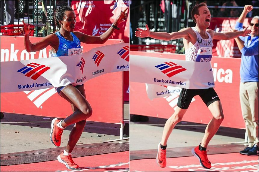 Galen Rupp became the first American to win the Chicago Marathon in 15 years and Ethiopian Tirunesh Dibaba ran away with the women's race on Sunday.
