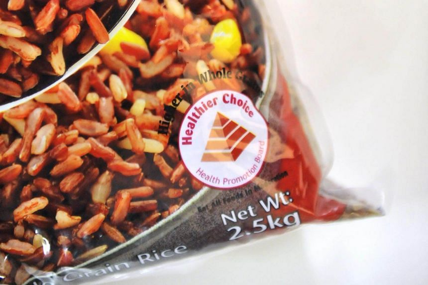 The Health Promotion Board's (HPB) healthier choice label on a pack of brown grains.  The Healthier Choice scheme, with its trademark red pyramid label, now applies to 3,500 products.
