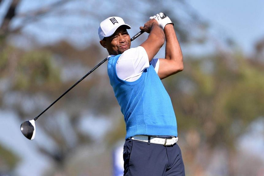 Tiger Woods tees off the 5th hole during the first round of the Farmers Insurance Open golf tournament at Torrey Pines Municipal Golf Course in La Jolla, California on Jan 26, 2017.
