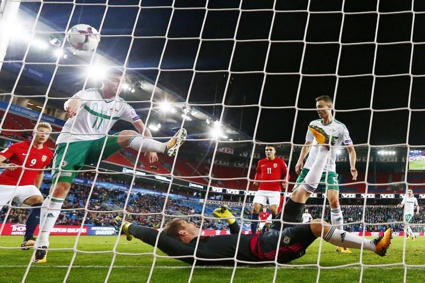 Chris Brunt of Northern Ireland (2nd left) scores an own goal during the FIFA World Cup 2018 qualification match in Oslo, Norway, on Oct 8, 2017.