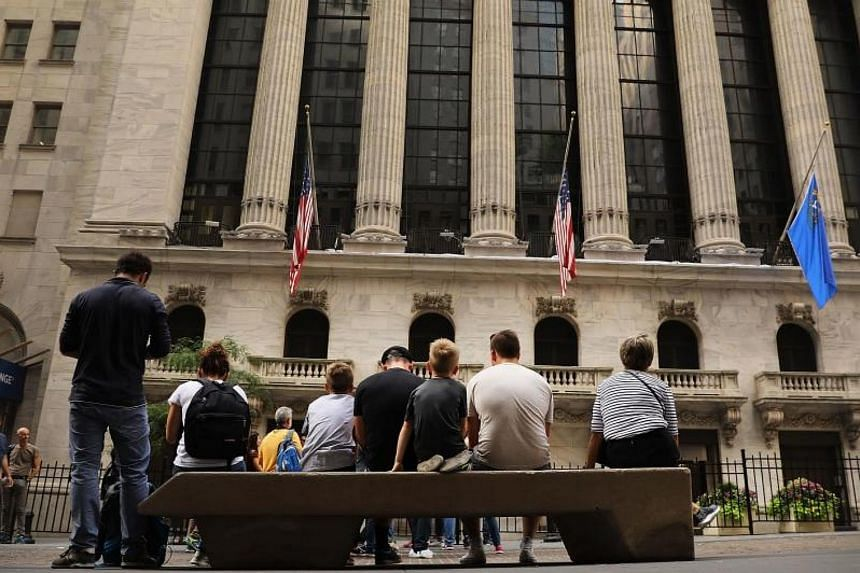 US stocks eked out enough gains on Monday to push the Dow Jones Industrial Average and the Nasdaq Composite to fresh records ahead of the start of the third-quarter earnings season.