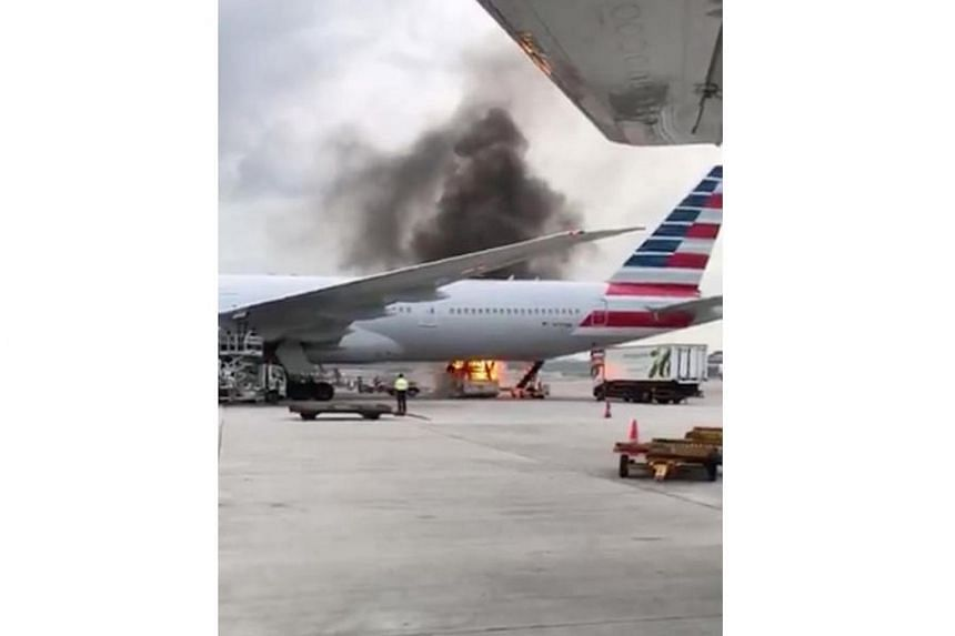 The fire started in one of the parking berths while a vehicle was loading cargo onto the plane.