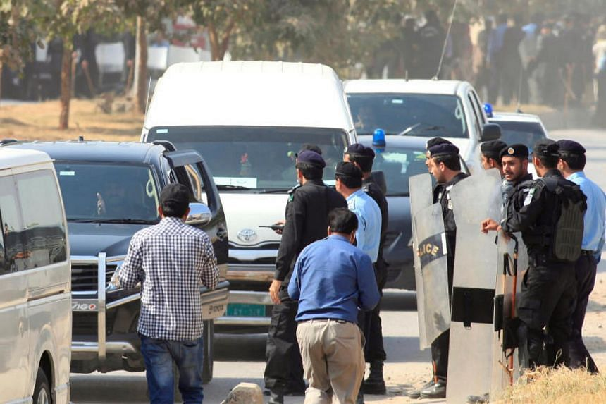 A vehicle carrying Muhammad Safdar, son-in-law of ousted Pakistani premier Nawaz Sharif, arrives at National Accountability Bureau (NAB) court in Islamabad, Pakistan on Oct 9, 2017.