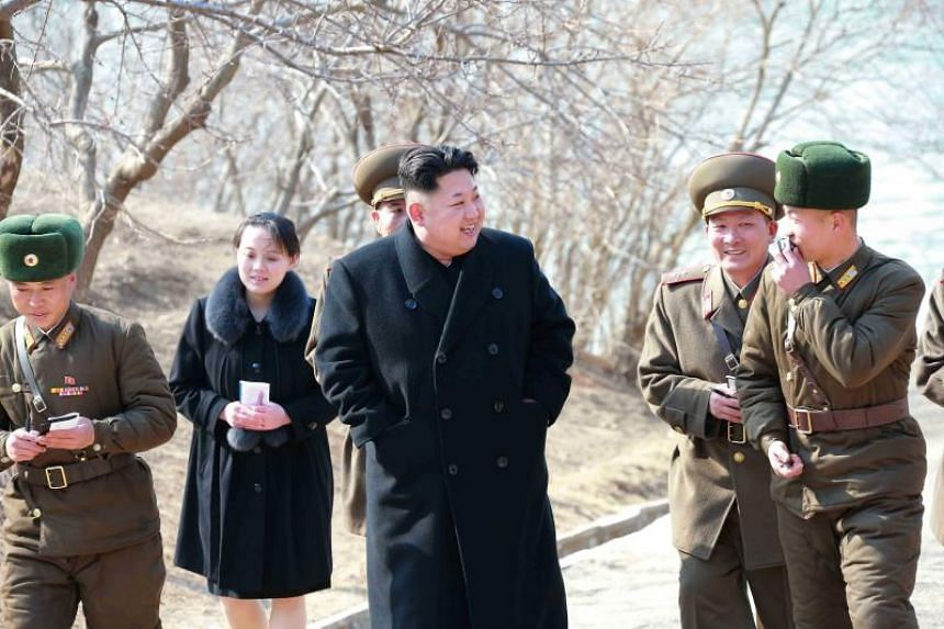 Kim Yo Jong is seen accompanying her brother Kim Jong Un during a tour of a military unit on an island off the North Korean mainland in this undated photo released in March 2015.