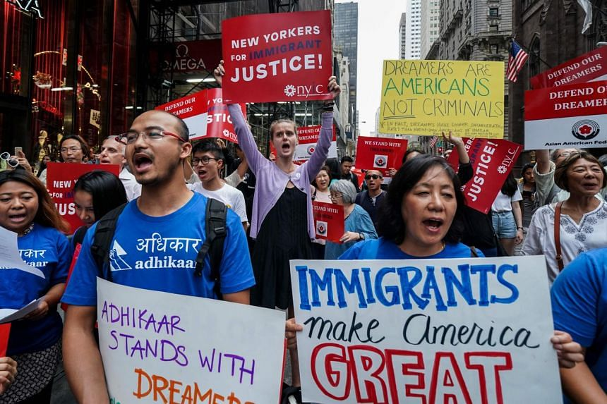 Protesters shout slogans during a demonstration in support of the Deferred Action for Childhood Arrivals, also known as Dream Act, near the Trump Tower in New York on Oct 5, 2017.