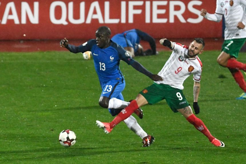 France's defender N'golo Kante (left) fights for the ball with Bulgaria's midfielder Spas Delev during the FIFA World Cup 2018 qualifying football match between Bulgaria and France at The Vasil Levski Stadium in Sofia on Oct 7, 2017.