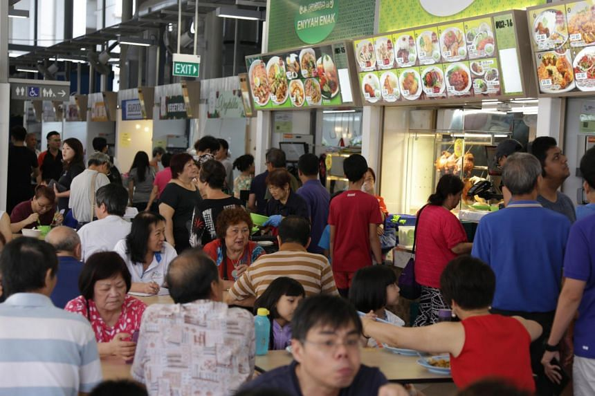 Patrons at the new Jurong West Hawker Centre. Information on the hawker trade will be available at the one-Stop Information and Service Centre located at the HDB Hub in Toa Payoh.