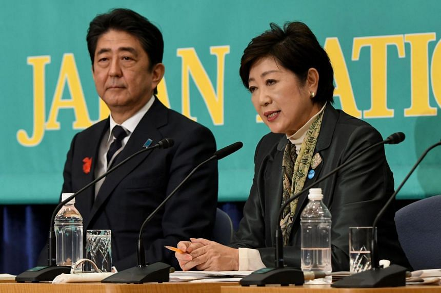 Tokyo Governor and head of the Party of Hope Yuriko Koike (right) answers questions beside Japanese Prime Minister and President of the ruling Liberal Democratic Party President Shinzo Abe during a political debate ahead of the general elections in T