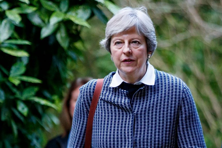 British Prime Minister Theresa May arrives to attend the Sunday morning service at a church in her Maidenhead constituency in Berkshire, east of Reading in southern England, on Oct 8, 2017.