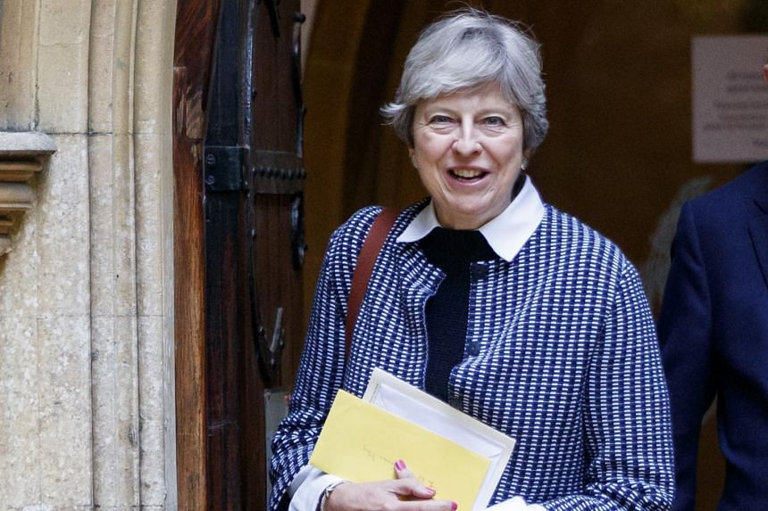 """British Prime Minister Theresa May leaves a church in Berkshire, in southern England, on Oct 8, 2017. Mrs May will use a speech in the House of Commons to urge both sides to show """"flexibility"""" in seeking a deal on Britain's withdrawal from the EU."""
